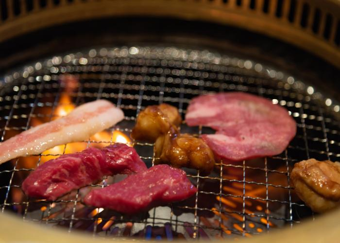 Horumon, Japanese offal, pieces of Japanese local beef being grilled over flame