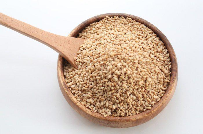 Sesame seeds in a wooden bowl