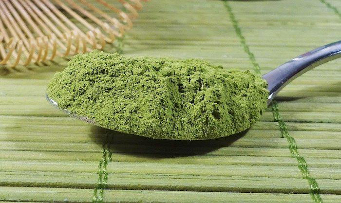 Matcha Green tea on a spoon on a bamboo mat