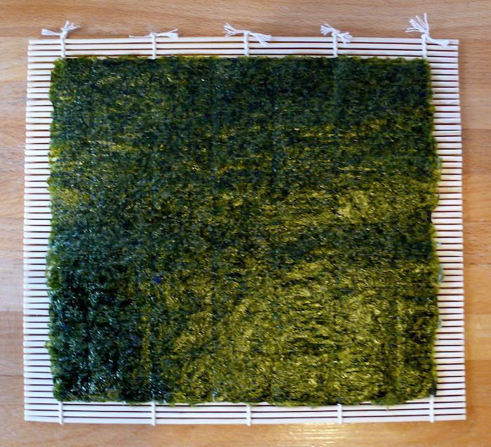 Sheet of nori seaweed on a bamboo sushi mat