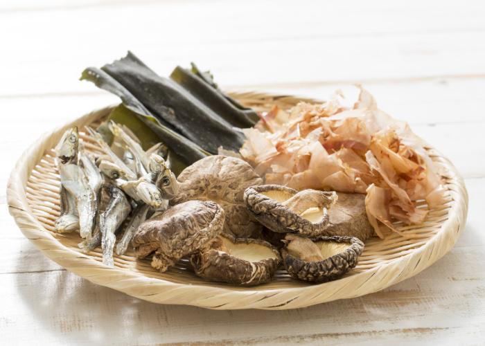 Dashi ingredients including shiitake mushrooms, katsuobushi, and kombu
