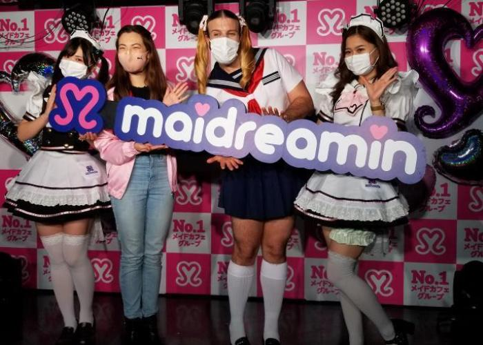 Shizuka and Ladybeard onstage with two girls dressed in maid uniforms at Maidreamin in Akihabara