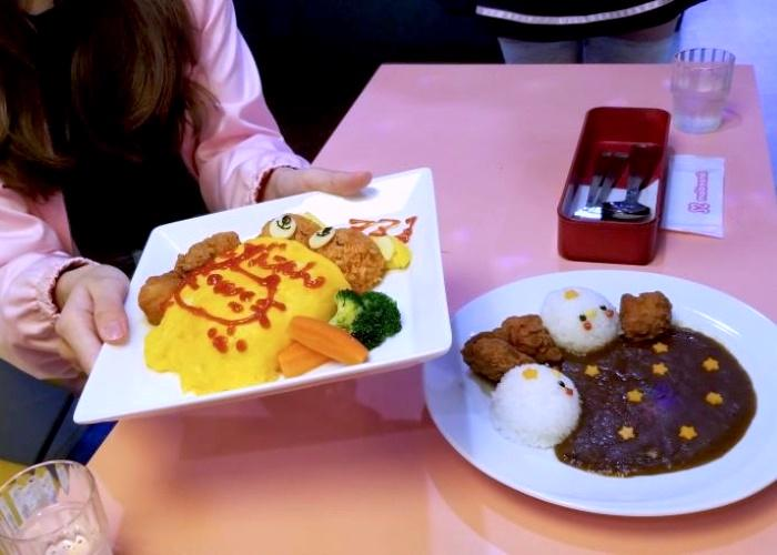 A plate of omurice and karaage fried chicken at Maidreamin Maid Cafe in Tokyo