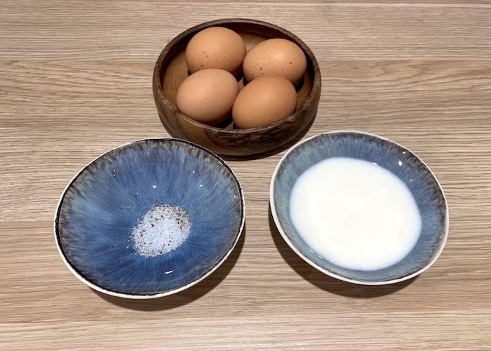 Omelette ingredients in bowls