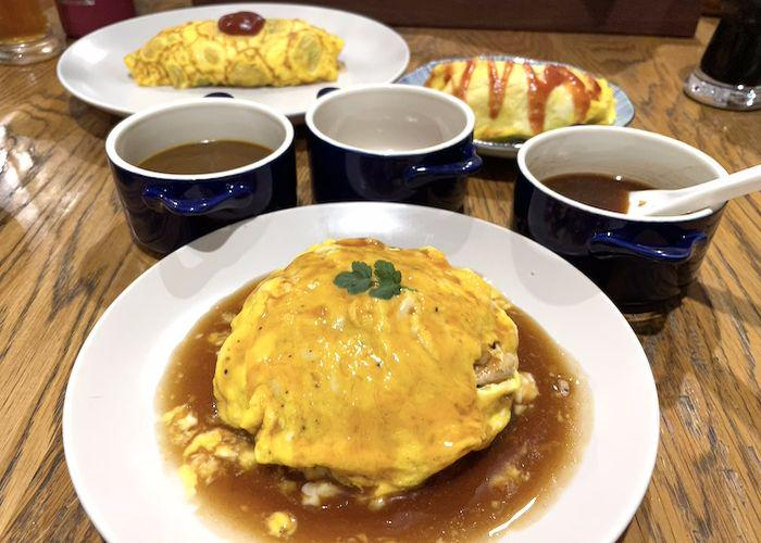 3 Different Types of Omurice on a wooden table