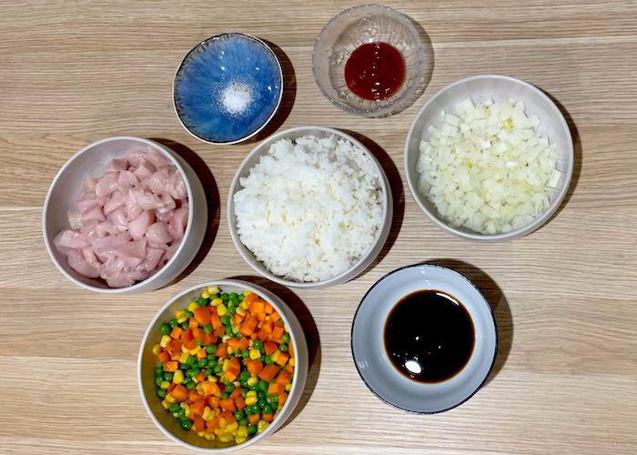 Ingredients for chicken fried rice in bowls