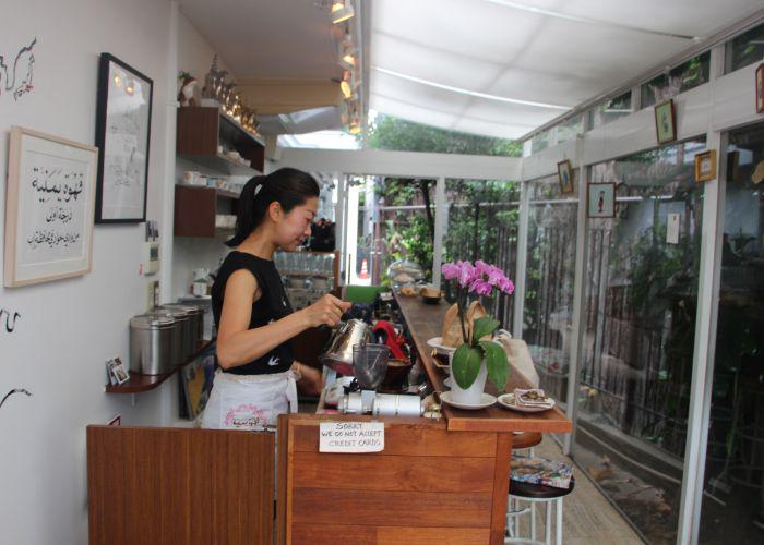 the owner is making coffee
