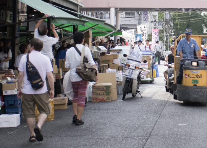 people are walking in Tsukiji Outer market