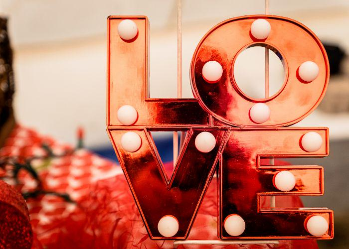 Love sign against a red and white background