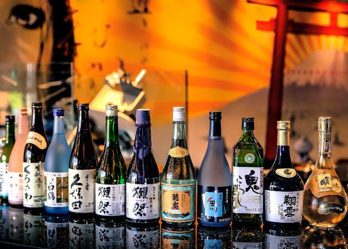 numerous bottles of Japanese sake
