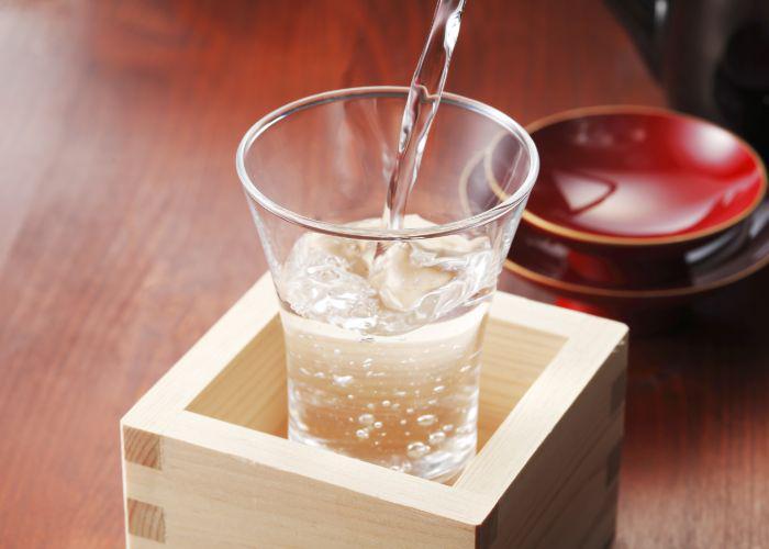 Sake served in a mashu box