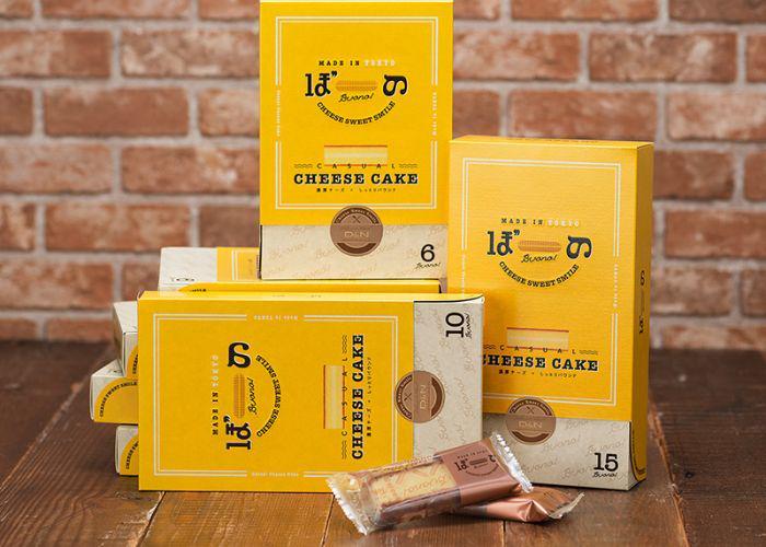 Yellow boxes of Tokyo Buono cheesecake