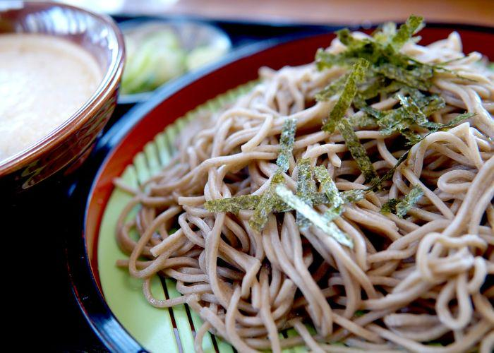 Zaru soba, a type of cold soba noodles on a bamboo basket, with nori flakes