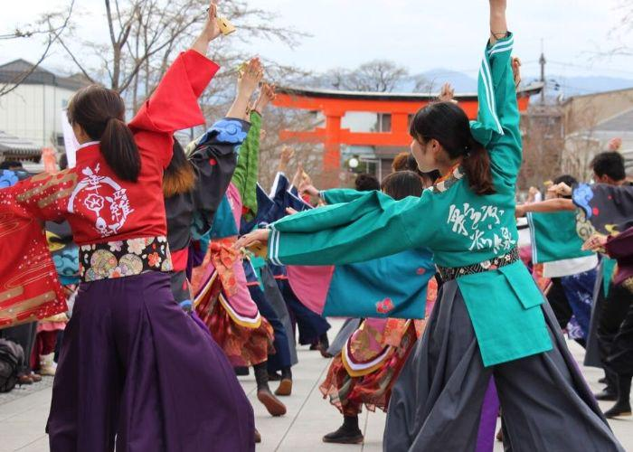 Students in colorful Japanese traditional dress dance during the  Kyoto Intercollegiate Festival outside