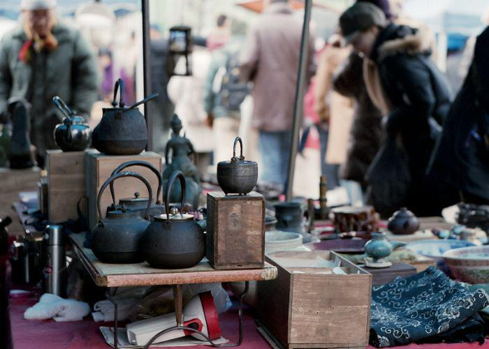 Iron kettles displayed for sale at a market at Toji Temple in Kyoto