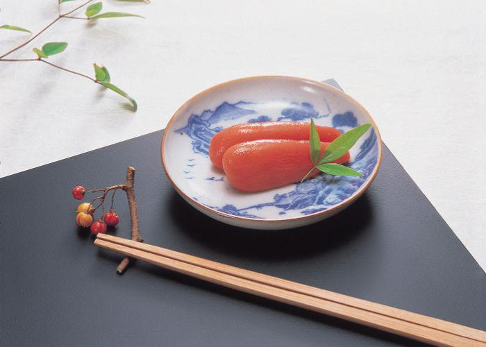 Dark pink mentaiko, fish egg, clusters plated elegantly on blue and white porcelain