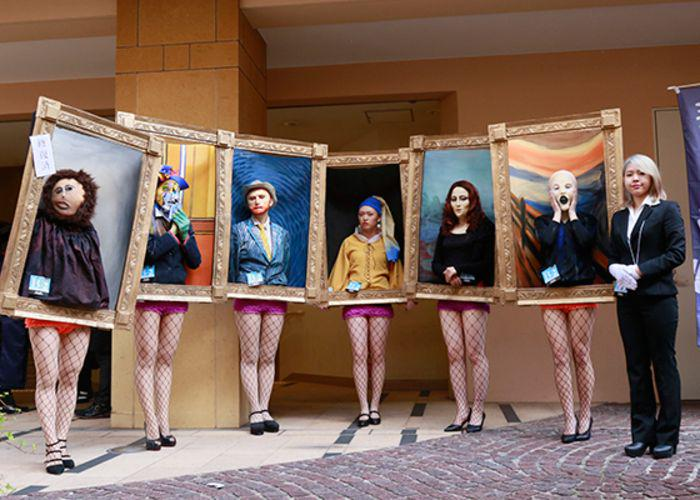 Halloween costume content with 5 people dressed as figures from popular artworks, like Mona Lisa, Van Gogh, and the Scream by Edvard Munch