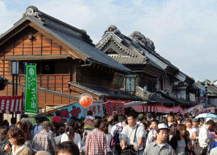 Crowds of people along the ancient street, with buildings from the Edo period, during the Kawagoe Matsuri