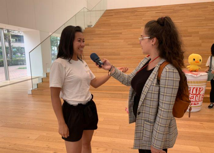 Tabesugi podcast host Emilie Lauer interviews a woman at the Cup Noodles Museum
