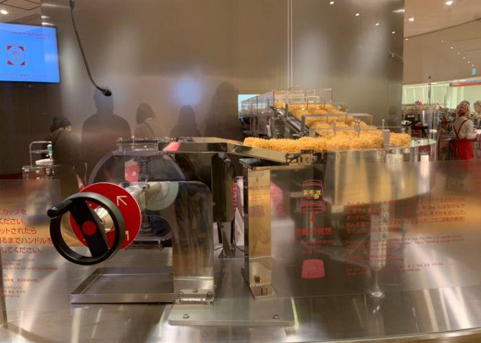 Instant ramen blocks on a conveyor belt at the Cup Noodles Museum in Yokohama
