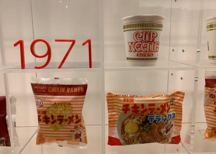 """Cup Noodles Museum in Yokohama shows the history of instant noodles. A sign reads """"1970s"""" and shows 3 types of instant ramen noodle packaging"""
