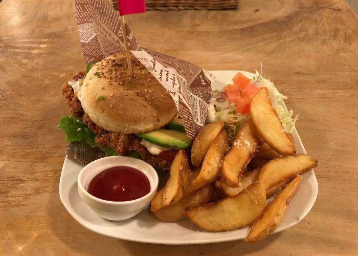 A white plant with thick-cut fries, ketchup, and a Morpho Cafe fish burger