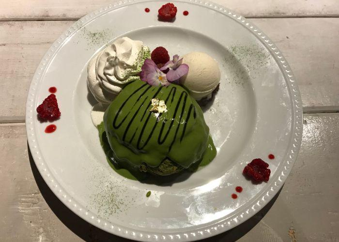 Delicious and decadent matcha pancakes from Ain Soph Journey, decorated with edible flowers