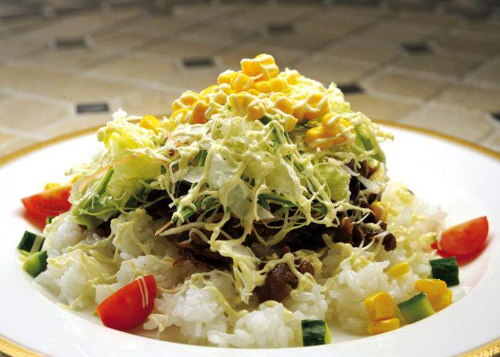 Saga's Sicilian rice dish, with a base of Japanese rice and layers of meat and vegetables, with a drizzle of mayo