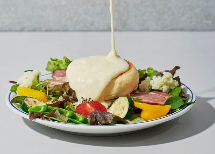 Flipper's savory pancakes on a bed of colorful veggies