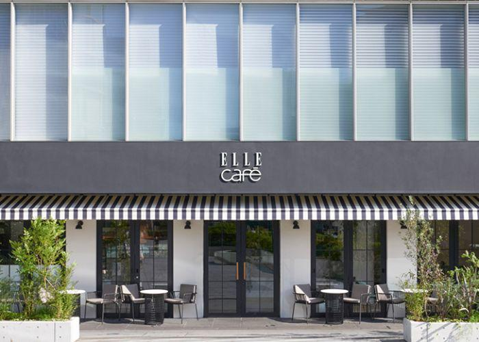 Exterior of Elle face, with tables set up outside and a black and white color palette
