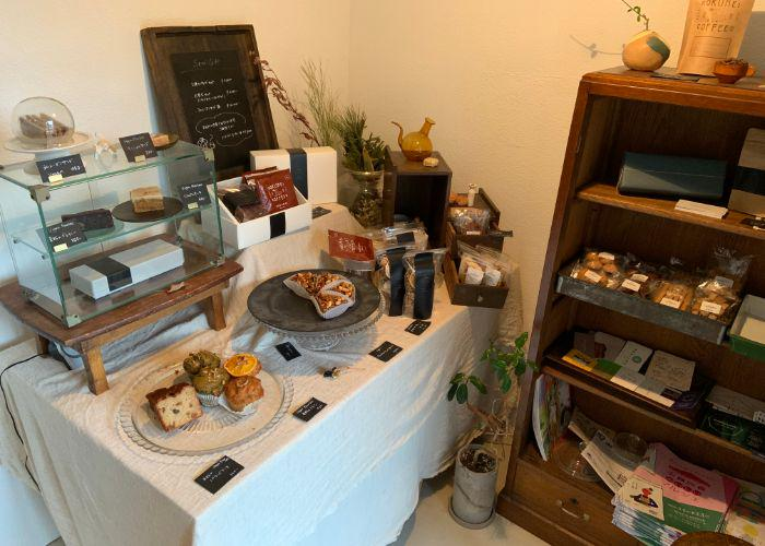 Somi Sweets interior, a vegan restaurant in Nara, with a table full of various based goods like pound cake and muffins displayed