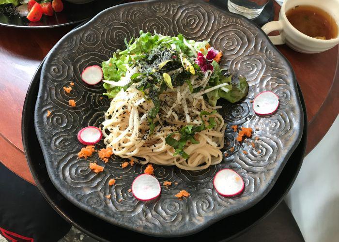 A colorful plate of pasta from Natural Life Kururu, a vegan restaurant in Kobe
