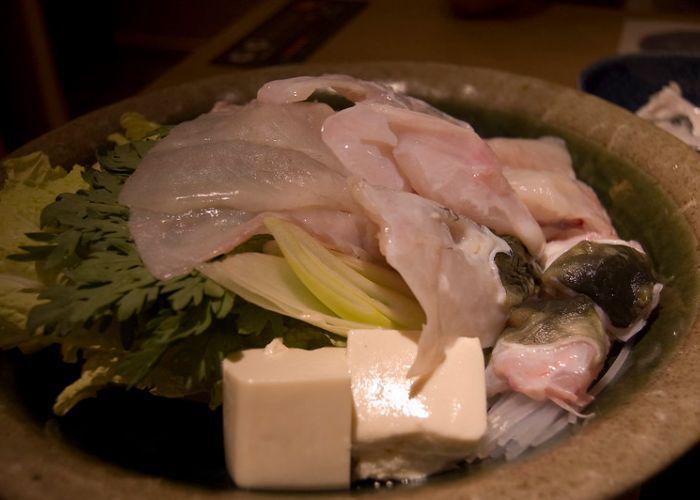 Fugu hot pot with raw fugu blowfish