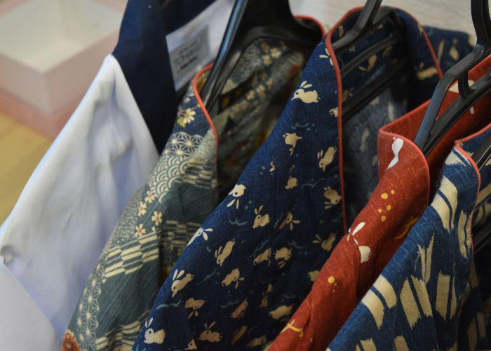 A line up of traditional Japanese jackets in different colorful patterns