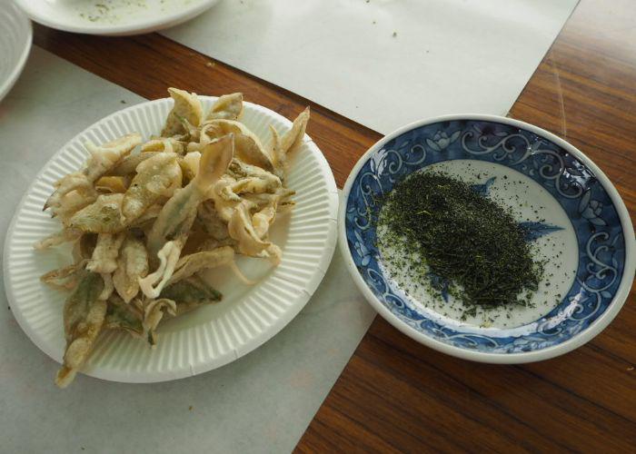 Tea leaf tempura and tea salt on a table