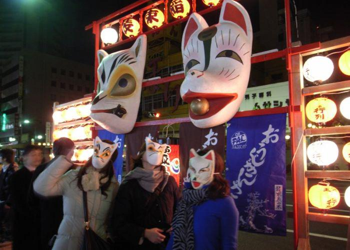 A group of people in fox masks celebrating the Oji fox festival