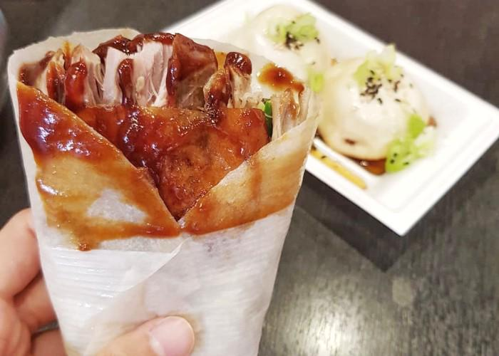 A thin crepe-like pancake wrapped around pieces of Peking duck