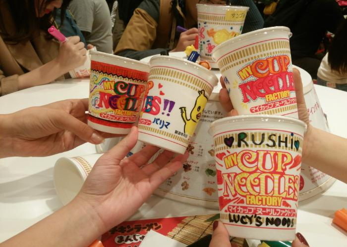 Various Cup Noodles during the decorating process at the Cup Noodle Museum