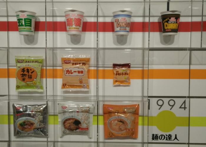 A wall at the Cup Noodles Museum of Osaka shows various types of ramen through the ages