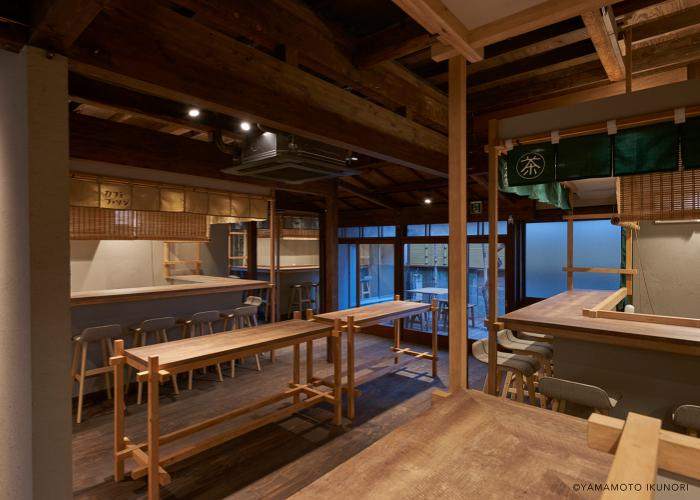 Interior of the Mikan Club cafe in Urasando Garden, with rustic wooden tables and chairs