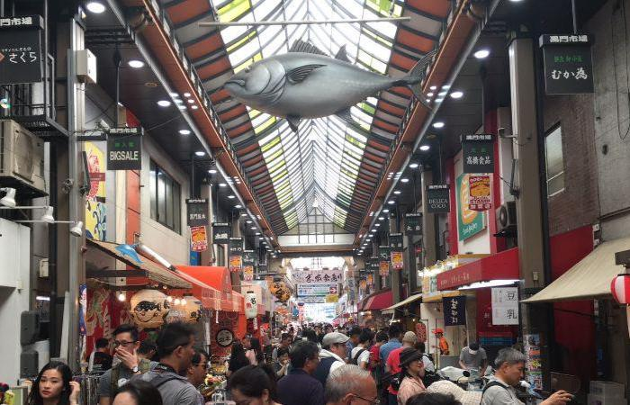 Street in Kuromon Market lined with people