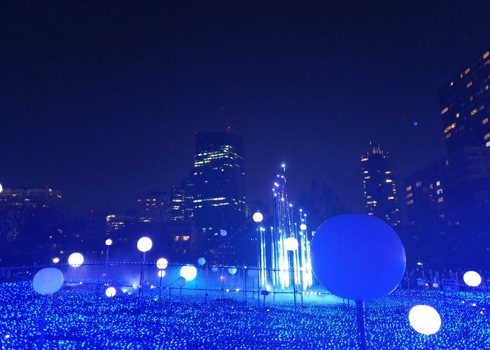 Blue illuminations at Roppongi Hills with a backdrop of the city