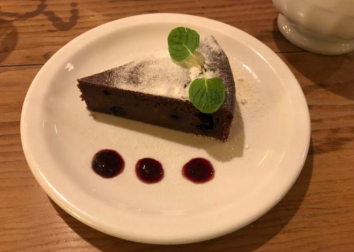 A slice of moist chocolate cake froma vegan-friendly cafe in Kobe