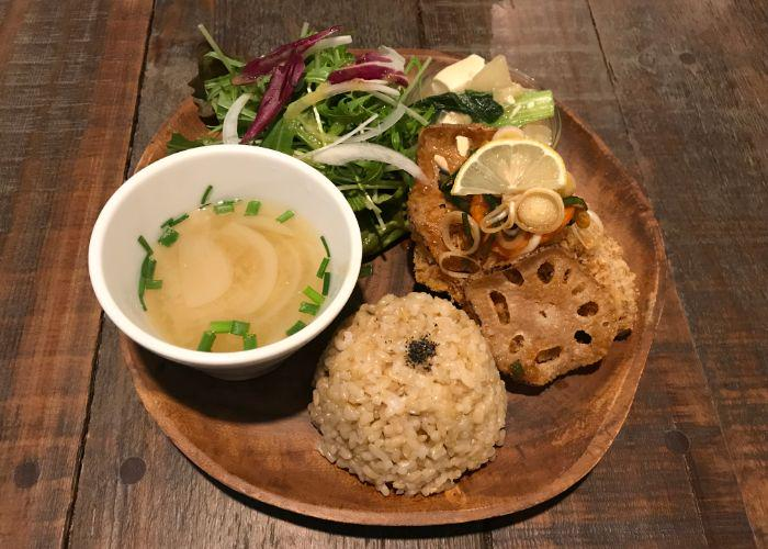 Plant-based lunch meal from Yidaki Cafe in Kobe, with brown rice, fried vegetables, soup, and salad