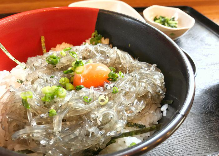 A bowl of sakura eels on a bed of rice