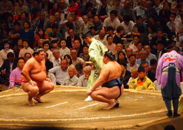 Two sumo wrestlers in a match area