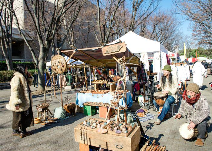 earth garden festival stall selling wooden crafts