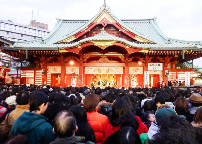 A huge crowd of people queuing for hatsumode at a local shrine
