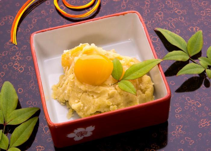 A box of kuri-kinton, a classic osechi ryori dish in Japan, mashed sweet potato and a candied chestnut