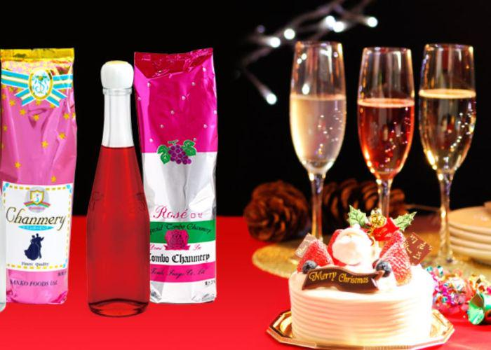 Chanmery bottles and flutes on a table with a white Christmas cake